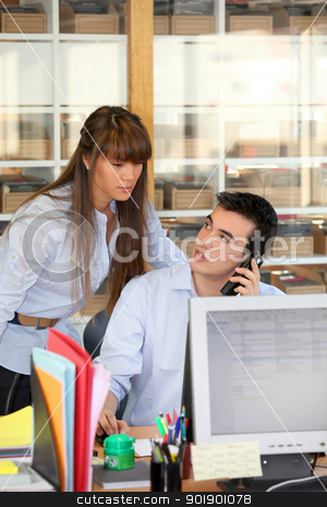 Young couple working at an office desk stock photo, Young couple working at an office desk by photography33