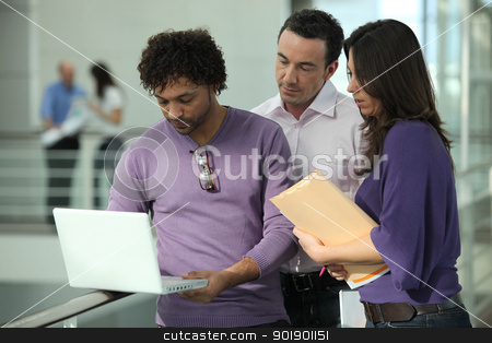 Colleagues looking at a laptop stock photo, Colleagues looking at a laptop by photography33