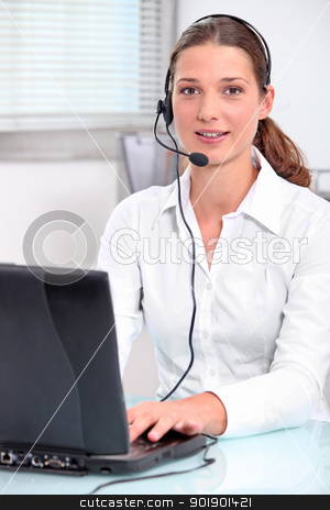 Young secretary with headphones and microphone stock photo, Young secretary with headphones and microphone by photography33