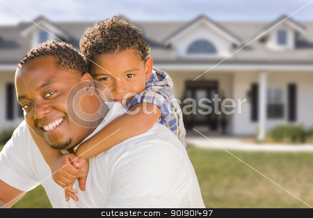 Mixed Race Father and Son In Front of House stock photo, Happy Playful African American Father and Mixed Race Son In Front of House. by Andy Dean