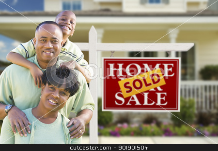 African American Family In Front of Real Estate Sign and House stock photo, Happy African American Family In Front of Sold Real Estate Sign and House. by Andy Dean