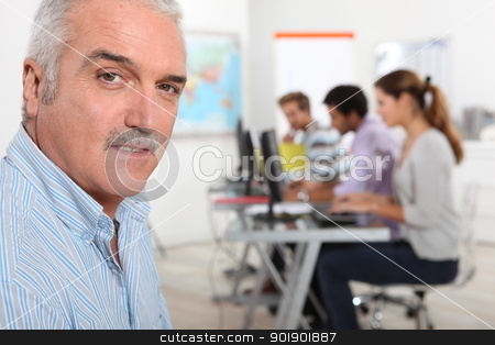 A teacher in his classroom stock photo, A teacher in his classroom by photography33