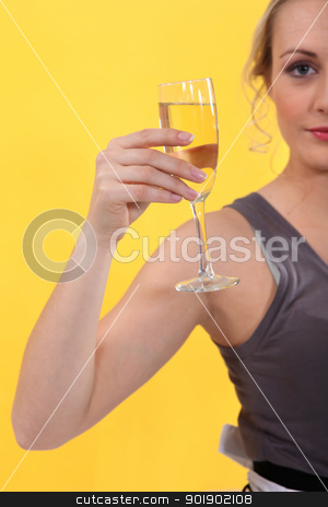 Woman holding glass of champagne stock photo, Woman holding glass of champagne by photography33