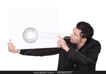 Man in suit carrying panel for message stock photo, Man in suit carrying panel for message by photography33