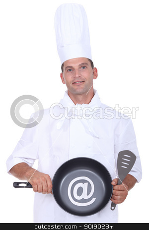 Male chef holding frying pan stock photo, Male chef holding frying pan by photography33