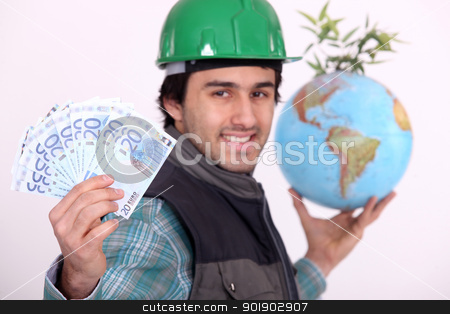 Manual worker holding globe and cash stock photo, Manual worker holding globe and cash by photography33