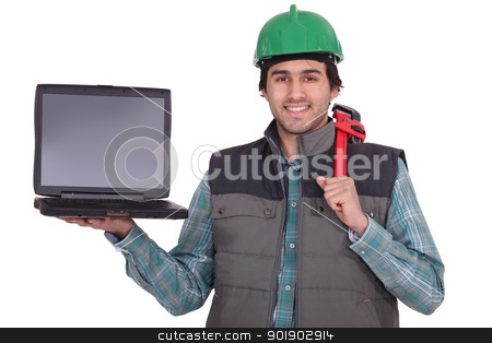 A manual worker holding a laptop stock photo, A manual worker holding a laptop by photography33