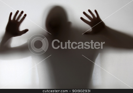 Shadowy figure trapped behind glass stock photo, Shadowy figure trapped behind glass by photography33