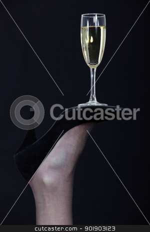 A champagne glass balanced on the sole of a shoe stock photo, A champagne glass balanced on the sole of a shoe by photography33