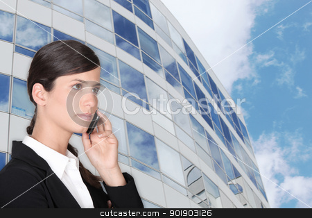 smart businesswoman making call outdoors near building stock photo, smart businesswoman making call outdoors near building by photography33