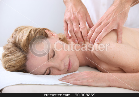 Woman enjoying back massage stock photo, Woman enjoying back massage by photography33