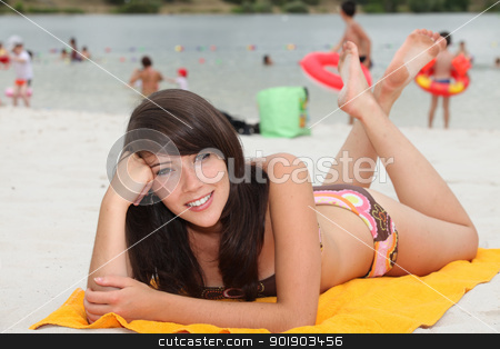 portrait of a young woman on the beach stock photo, portrait of a young woman on the beach by photography33