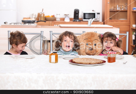 Young children eating crepes stock photo, Young children eating crepes by photography33