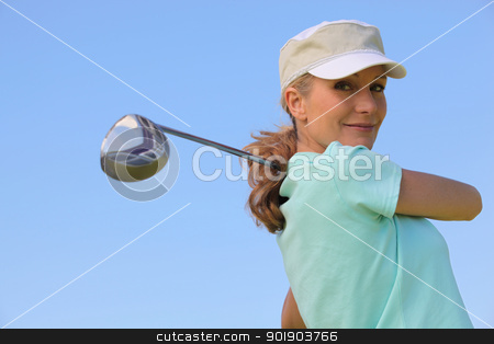 Golfer taking a swing stock photo, Golfer taking a swing by photography33