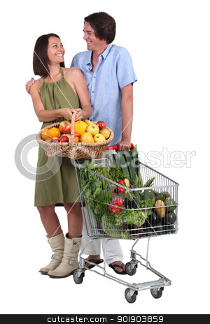 Couple buying fruit and vegetables stock photo, Couple buying fruit and vegetables by photography33