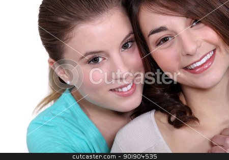 Two female friends hugging. stock photo, Two female friends hugging. by photography33