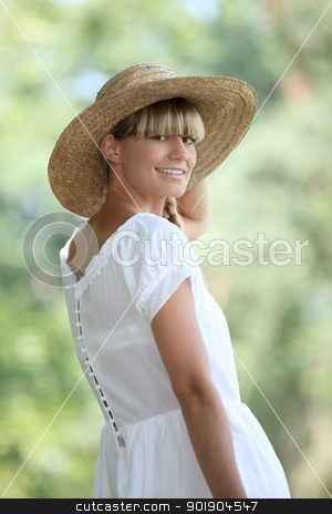 30 years old blonde woman wearing a white dress and a straw hat walking in the nature stock photo, 30 years old blonde woman wearing a white dress and a straw hat walking in the nature by photography33