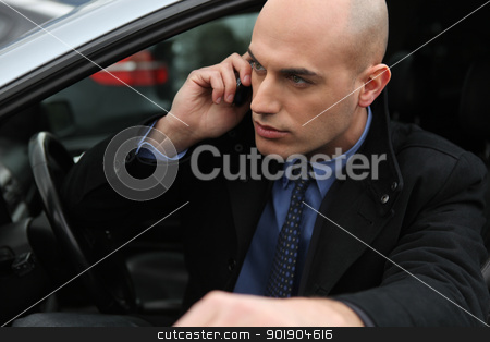 Bald man with mobile telephone getting into car stock photo, Bald man with mobile telephone getting into car by photography33
