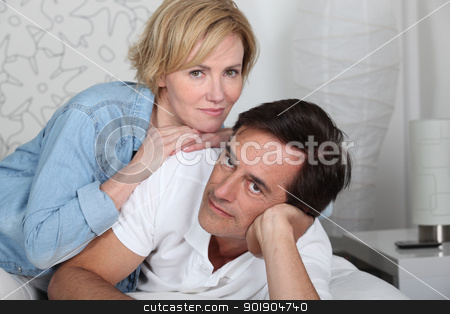 Couple lying on bed stock photo, Couple lying on bed by photography33