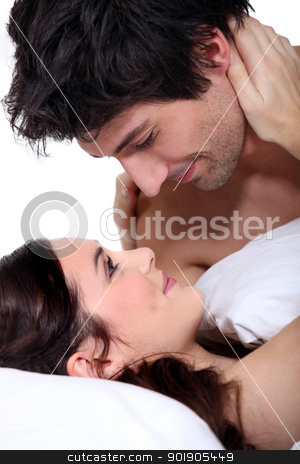 Husband and wife staring into each other's eyes stock photo, Husband and wife staring into each other's eyes by photography33