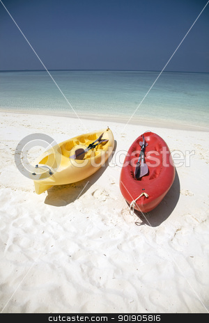 Canoes stock photo, A red and a yellow canoe resting on a sandy beach. by Abdul Sami Haqqani
