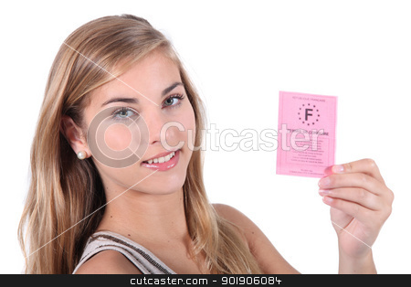 Teenager showing driving licence stock photo, Teenager showing driving licence by photography33
