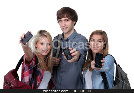 Teenagers showing mobile phones stock photo, Teenagers showing mobile phones by photography33