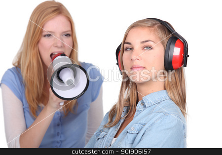 Girl shouting into speaker phone stock photo, Girl shouting into speaker phone by photography33