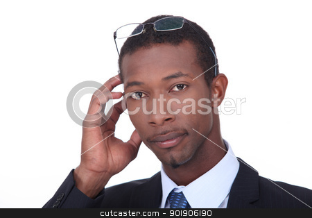 Black businessman with glasses on his head stock photo, Black businessman with glasses on his head by photography33