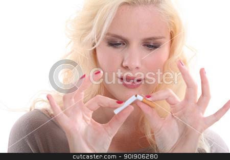woman breaking a cigarette stock photo, woman breaking a cigarette by photography33