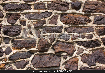 Stone Wall stock photo, Dark stone wall detail with irregular pattern. Background by Darren Pullman