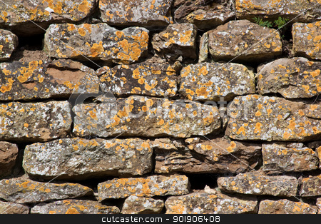 Dry Stone Wall stock photo, Dry stone wall covered with orange lichen by Darren Pullman