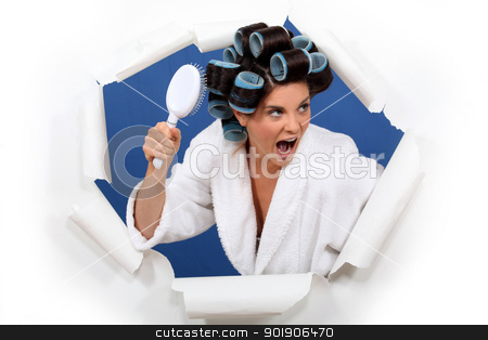 Angry woman with hair rollers and brush stock photo, Angry woman with hair rollers and brush by photography33