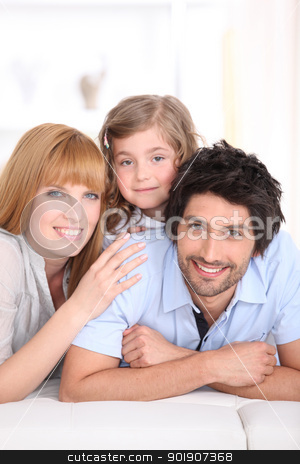 Family laying on a bed stock photo, Family laying on a bed by photography33