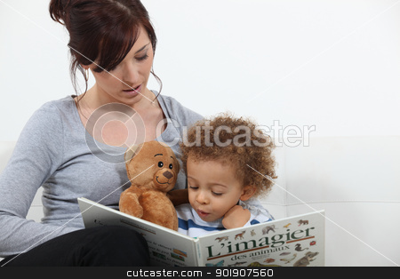 Mother reading story to son stock photo, Mother reading story to son by photography33