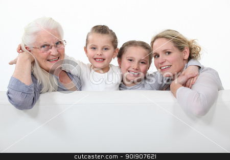 Grandmother, mother and daughters behind white sign stock photo, Grandmother, mother and daughters behind white sign by photography33