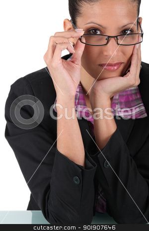 Businesswoman posing with glasses stock photo, Businesswoman posing with glasses by photography33