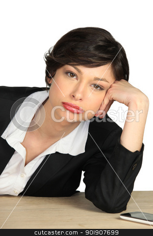 Bored employee leaning on her desk stock photo, Bored employee leaning on her desk by photography33