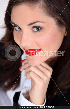 Seductive brunette with bright red lipstick stock photo, Seductive brunette with bright red lipstick by photography33