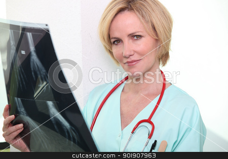 Female nurse holding x-ray image stock photo, Female nurse holding x-ray image by photography33