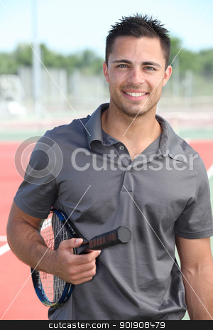 Male tennis player holding racquet on hard court stock photo, Male tennis player holding racquet on hard court by photography33