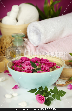 Spa composition stock photo, Spa setting with flowers, sea salt, towels and essential oil by klenova
