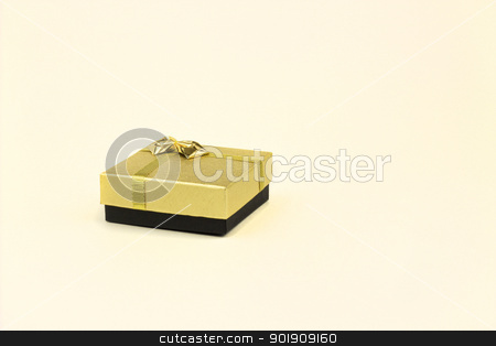 closed box stock photo, fine image of isolated gift box with golden ribbon by metrue