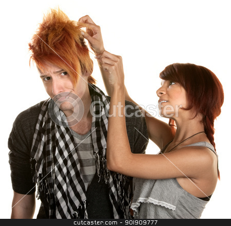 Lady Working with Man's Hair stock photo, Cute young woman picking at her friends hair by Scott Griessel