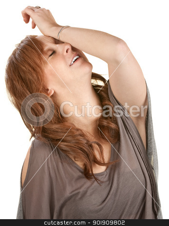 Relieved Young Woman stock photo, Relieved young red haired female with arm on face by Scott Griessel