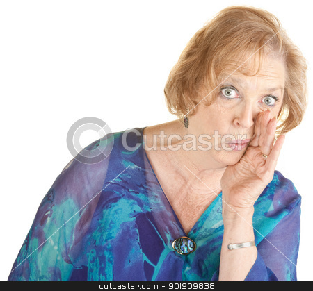 Senior Woman Whispering stock photo, Serious elderly woman with hand at mouth whispering by Scott Griessel