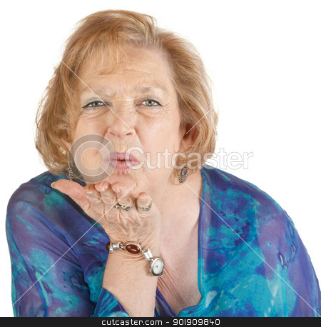 Woman Blowing a Kiss stock photo, Cute mature woman with hand out blowing a kiss by Scott Griessel