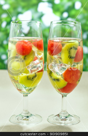 Kiwi Melon Sangria  stock photo, Kiwi Melon Sangria in front of green shrubbs by Ulrich Schade
