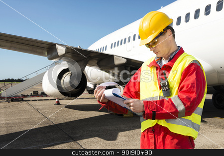 Aircraft engineer stock photo, Aircraft engineer with a checklist of several pages on a clipboard by Corepics VOF