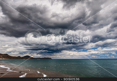 Sea and clouds stock photo, View of thunderstorm clouds above the sea by nvelichko